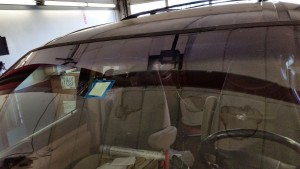 Broken windshield and incorrectly installed New Hampshire inspection sticker